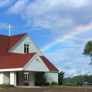 Front door of Champlin UMC church with rainbow